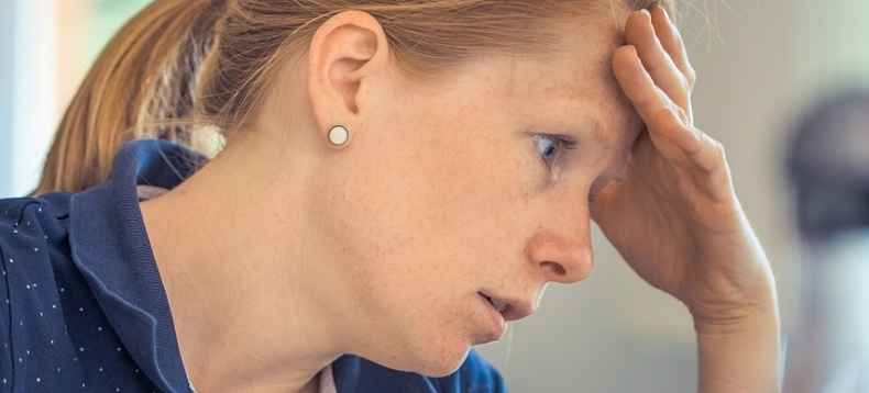 frustrated-woman-hand-on-head-realising-the-signs-of-poor-training-software-usability